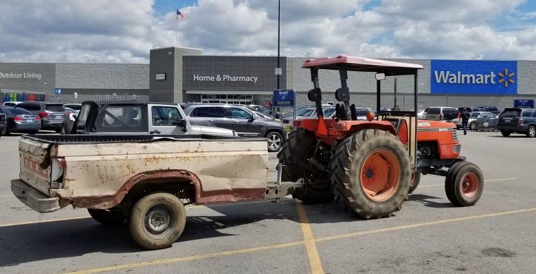 Farm tractor in WalMart parking lot.