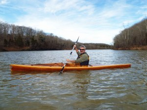 Brad Saum paddling his wooden kayak