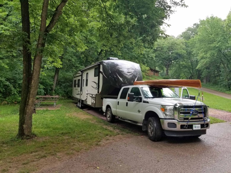 state park campground with RV parked in low cost camping site
