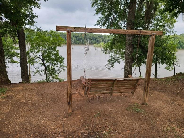 A swing set on the banks of the Alabama River at Jackson Lake Island