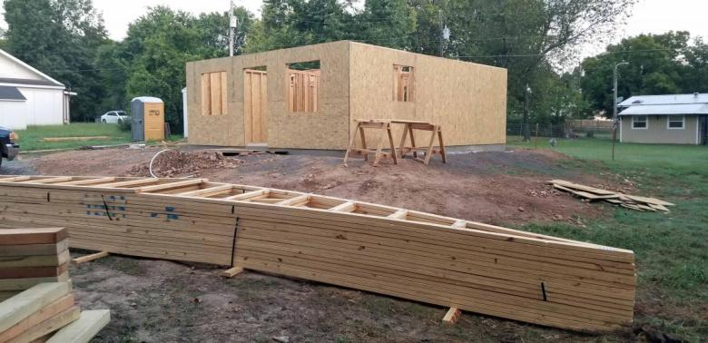 The house walls were framed when we arrived, and the roof trusses lay in front of the house ready to be installed.