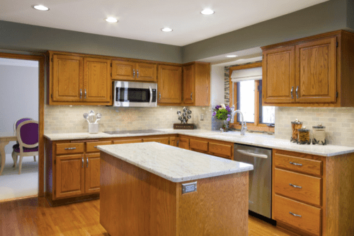 Oak cabinets with gray walls