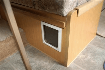 Cat door in side of dining booth - litter box storage idea for RVs, campers, or motorhomes