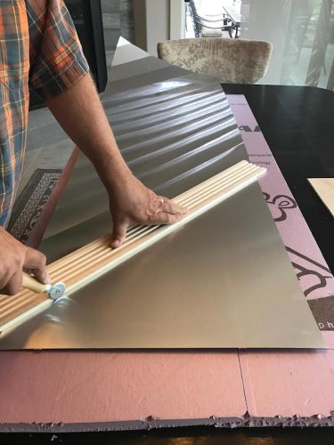 Making a faux stainless steel backsplash out of aluminum flashing for a vintage camper