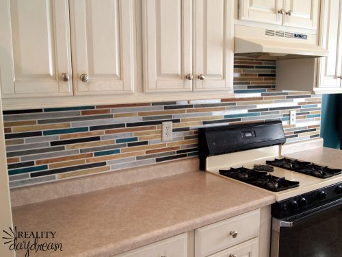 Painted mosaic tile backsplash