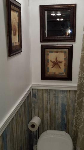 RV bathroom with beach wood wallpaper
