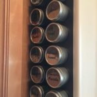 Spice tins sticking to DIY magnetic spice wall