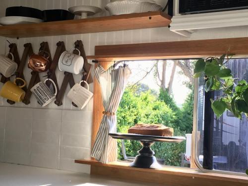 RV window framed in oak