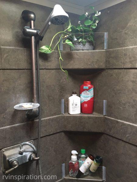 Plexiglass walls for #RV #shower shelves | rvinspiration.com | #storage and #organization ideas for your #camper, #motorhome, or #traveltrailer