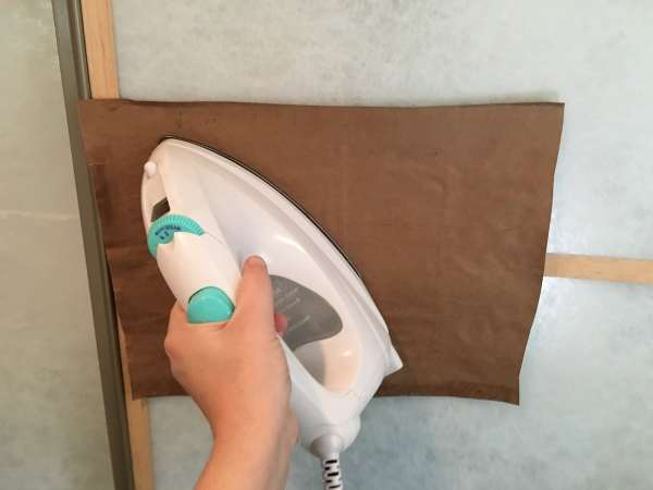 Using my iron to activate the glue