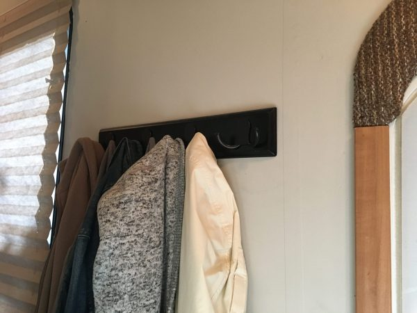 A coat rack is a good way to add #storage to a #camper or #motorhome