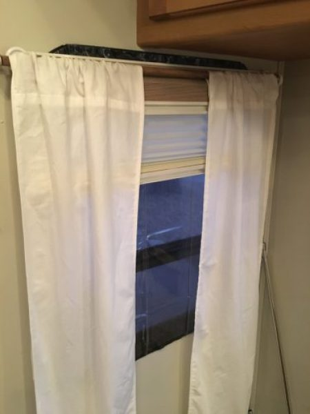 DIY removable clear vinyl screen covers attached with Velcro to insulate RV windows for cold weather or winter camping and living