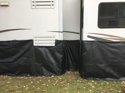Cheap DIY RV skirting for cold weather made from billboard vinyl