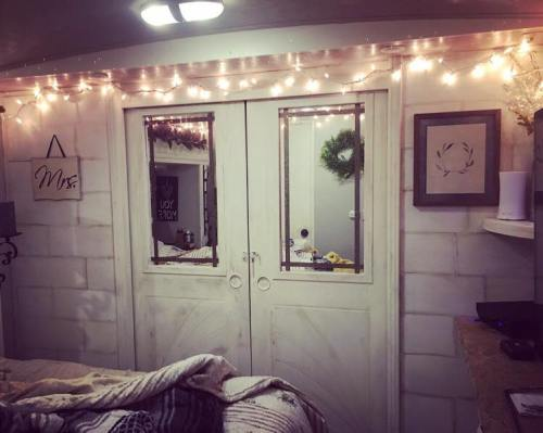 Peel and stick faux shiplap accent wall in a fifth wheel RV by Christina LaPlaca