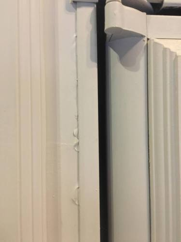 Score paint covering seams between trim pieces after painting inside a travel trailer or motorhome.