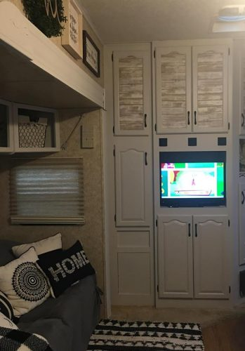 White painted trim and Farmhouse style decor in fifth wheel RV by Kimberlyn McFadden