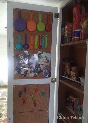 Adding cork board to the inside of a cabinet door is a good idea to help #organize and save space in an #RV #kitchen.
