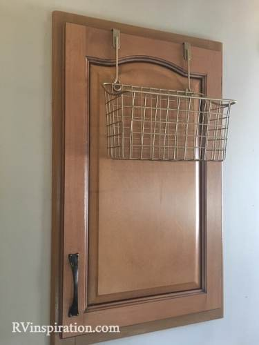 An over cabinet basket is a good way to add #storage to an #RV #kitchen.