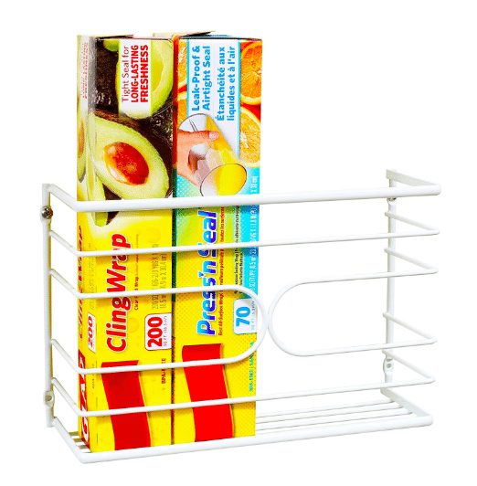 A wrap holder can be mounted under an RV kitchen cabinet to add extra storage to a camper.