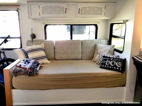 Custom built daybed in RV with storage under seat