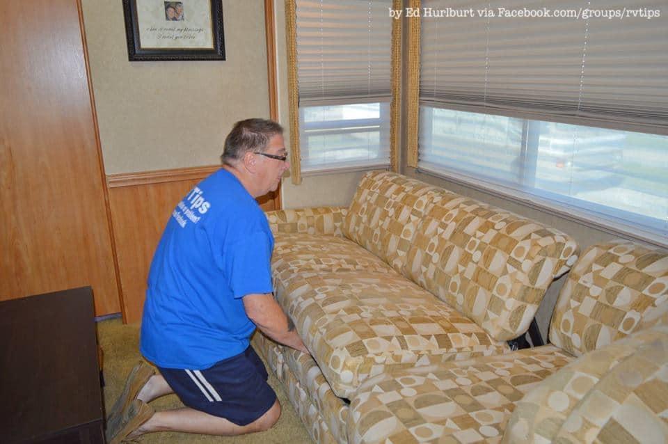 Ed Hurlbert, admin of RV Tips Facebook group, #removing his #RV #jackknife #sofa | rvinspiration.com