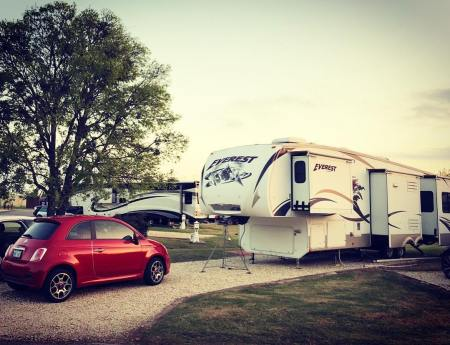 Our fifth wheel RV and my car)