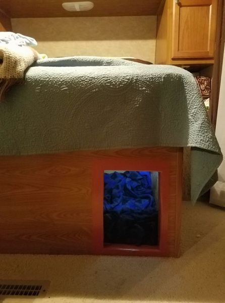 Dog door added under bed in fifth wheel RV