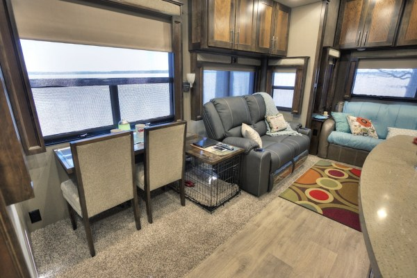 Living room furniture in fifth wheel reconfigured to make room for dog crate
