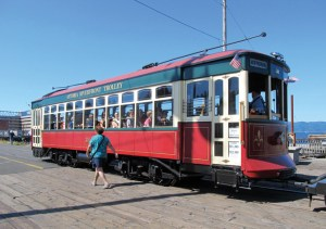 A restored 1913 trolley runs alongside the Astoria waterfront.