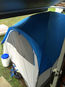 View of the tent from the door of the RV