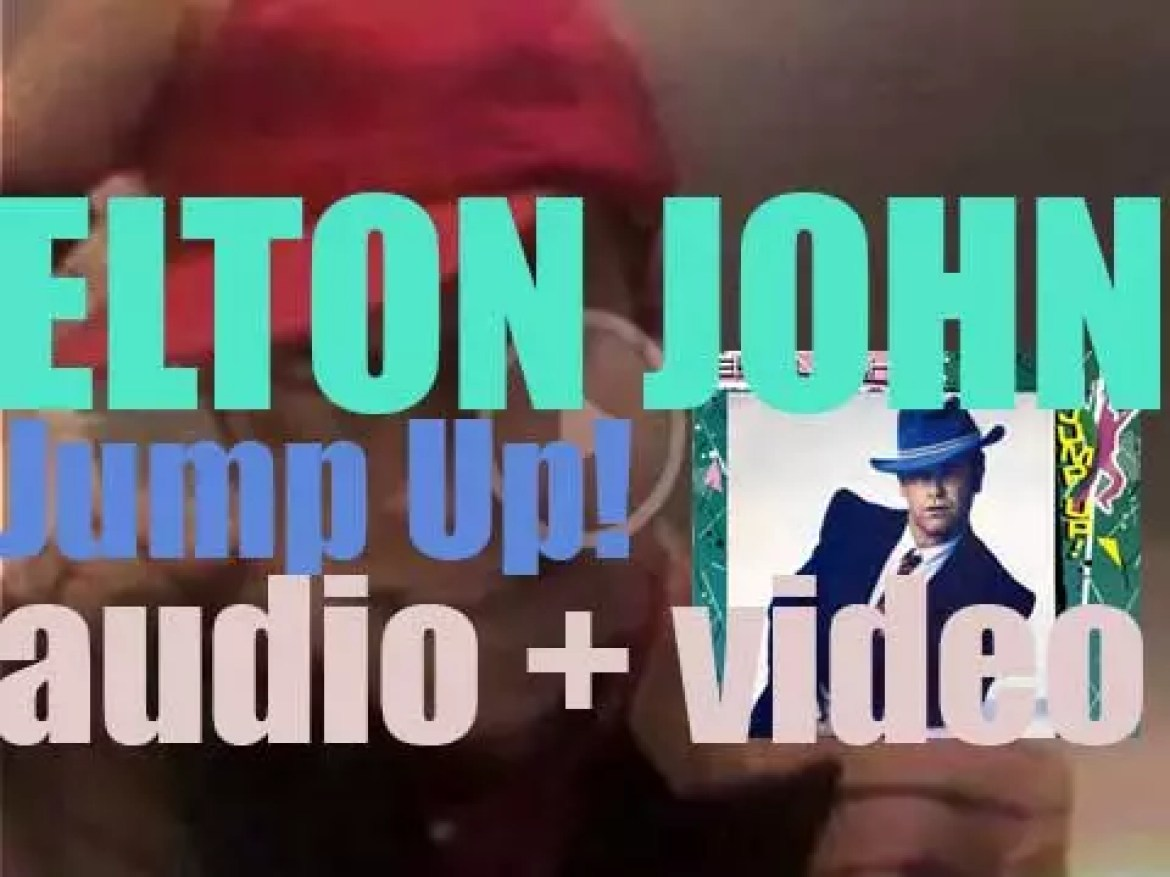 Elton John releases 'Jump Up!' his sixteenth album featuring 'Blue Eyes' (1982)