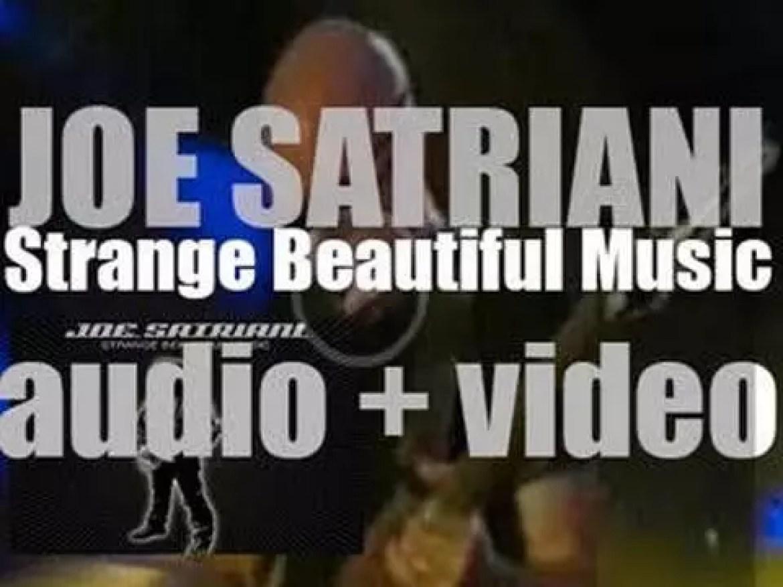 Joe Satriani releases his ninth album : 'Strange Beautiful Music' (2002)