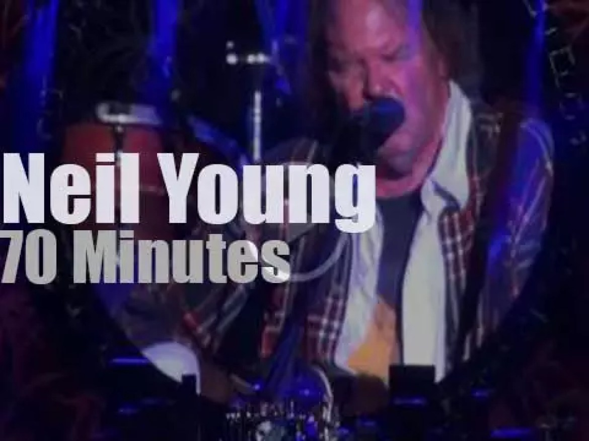 Neil Young performs against poverty (2012)
