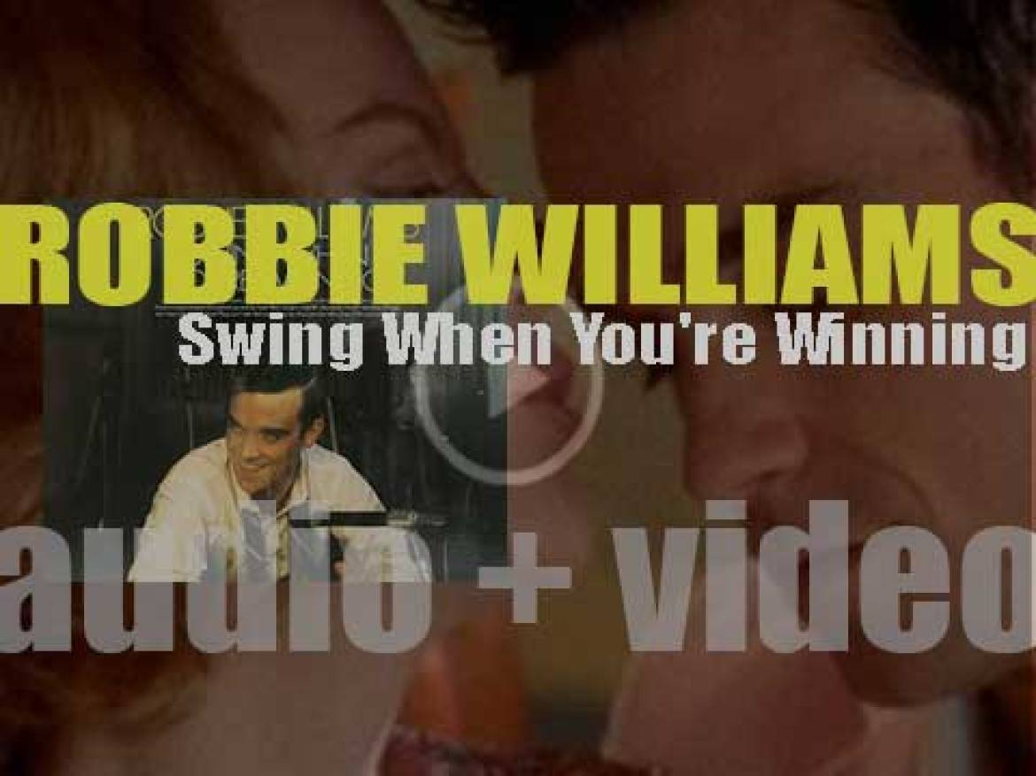 Robbie Williams releases his fourth album : 'Swing When You're Winning' featuring 'Somethin' Stupid,' a duet with Nicole Kidman (2001)