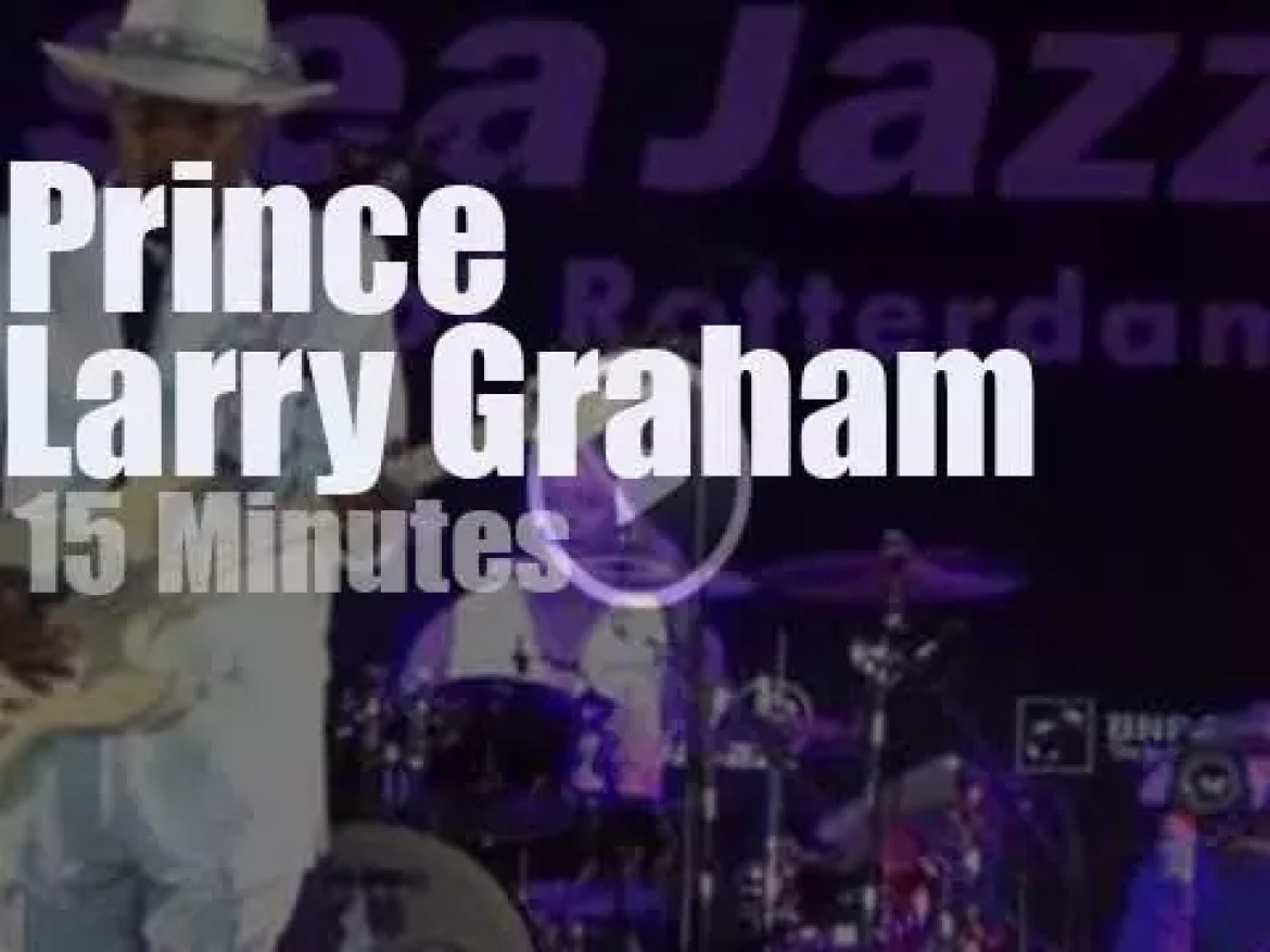Larry Graham slaps his bass then Prince walks in (2013)