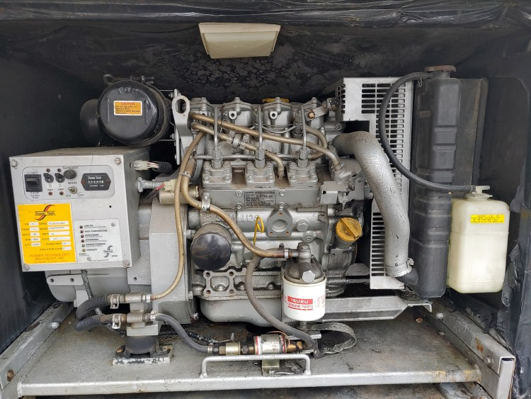 Power Tech RV generator being inspected during RV inspection