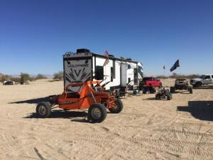 RV Rental in desert with ATV's in Sand