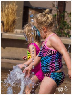 Sisters Playing in Fountain