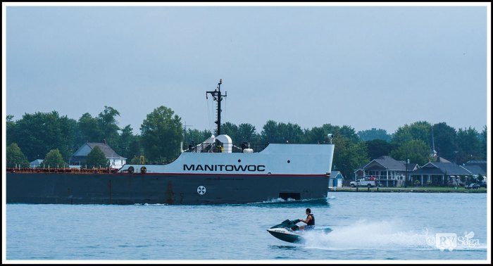 A Jet Boat Riding by Manitowoc with Canada in the Background
