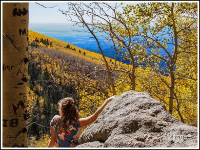 A Girl Sitting on A Boulder Enjoying the View