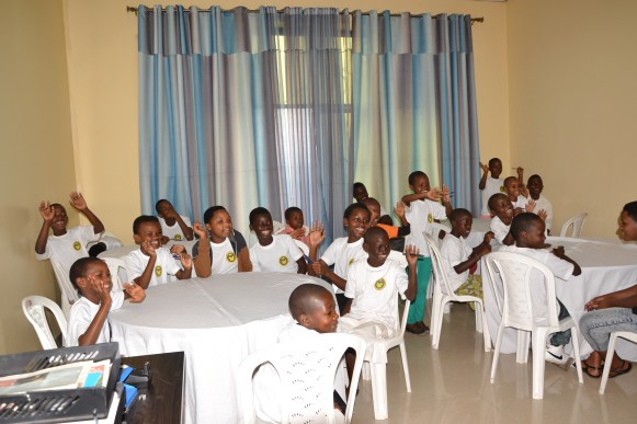 Children meet at RCEF to write to sponsors.