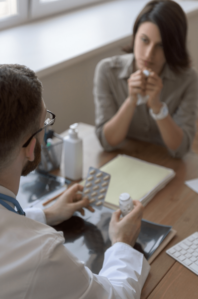 Pharmacist prescribing for sick woman with flu