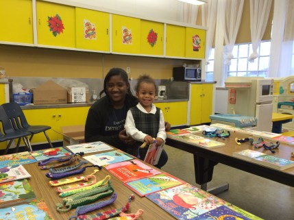 UDM student Maegan McFarland helps a young RX for Reading preschooler pick out a new book.