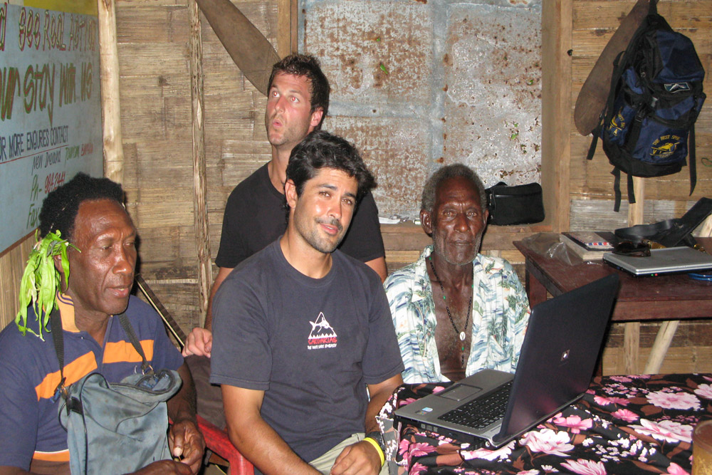 Showing Blaize and Salam some of my sound recordings of there shark calling rattles - Dave looking interested
