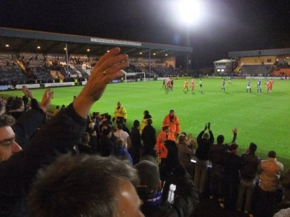 The away fans celebrate the 3-2 victory
