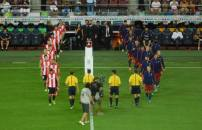 The teams enter the field