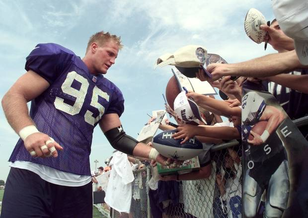 Chad Hennings was a fan-favorite during his nine years with the Cowboys.  Here, he signs autographs for a crowd after a training camp practice session in Austin, Texas.