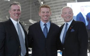 Dallas Cowboys head coach Jason Garrett, center, posses for photos with team owner Jerry Jones, right, and his son Stephen Jones during an NFL football news conference at Cowboys Stadium in Arlington, Texas, Thursday, Jan. 6, 2011.  Garrett was officially named head coach. (AP Photo/LM Otero)