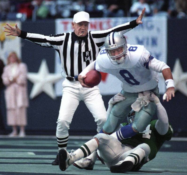 Cowboys rookie QB Troy Aikman gets thrown down in the end-zone by Eagles linebacker Brent Hager well after the play had been stopped during the infamous Bounty Bowl of 1989.