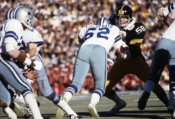 Jack Lambert was a key figure in Pittsburgh keeping the Cowboys' powerful rushing attack in check in Super Bowl X. But it was his efforts on one special teams play that people remember the most. Here, Dallas center John Fitzgerald tries to move Lambert out of the way and open up a running lane for running back Preston Pearson.
